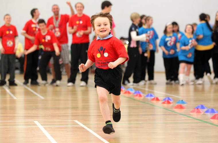Boy running in a sports hall