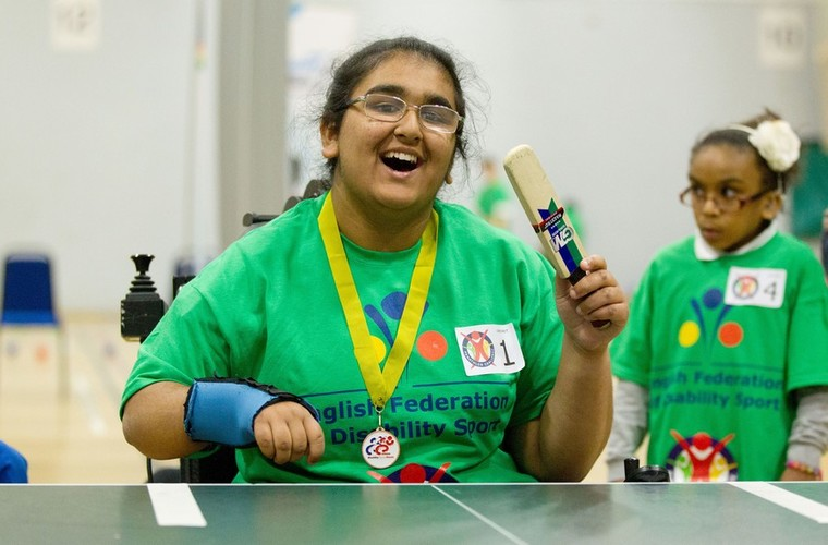 Girl playing table cricket