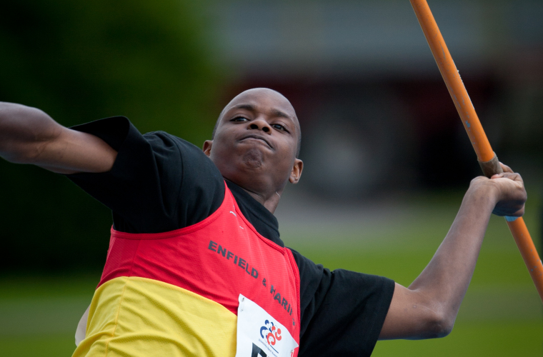 Junior athlete throwing a javelin