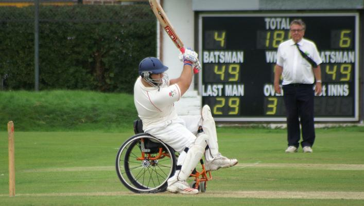 Man in a wheelchair playing cricket