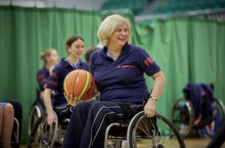 Woman playing wheelchair basketball