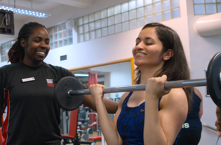 Chandni works out in the gym with an instructor by her side