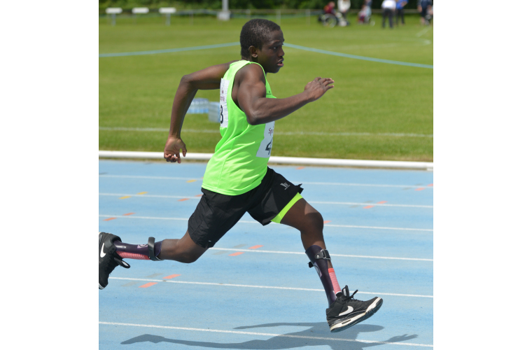 A disabled boy running on the track