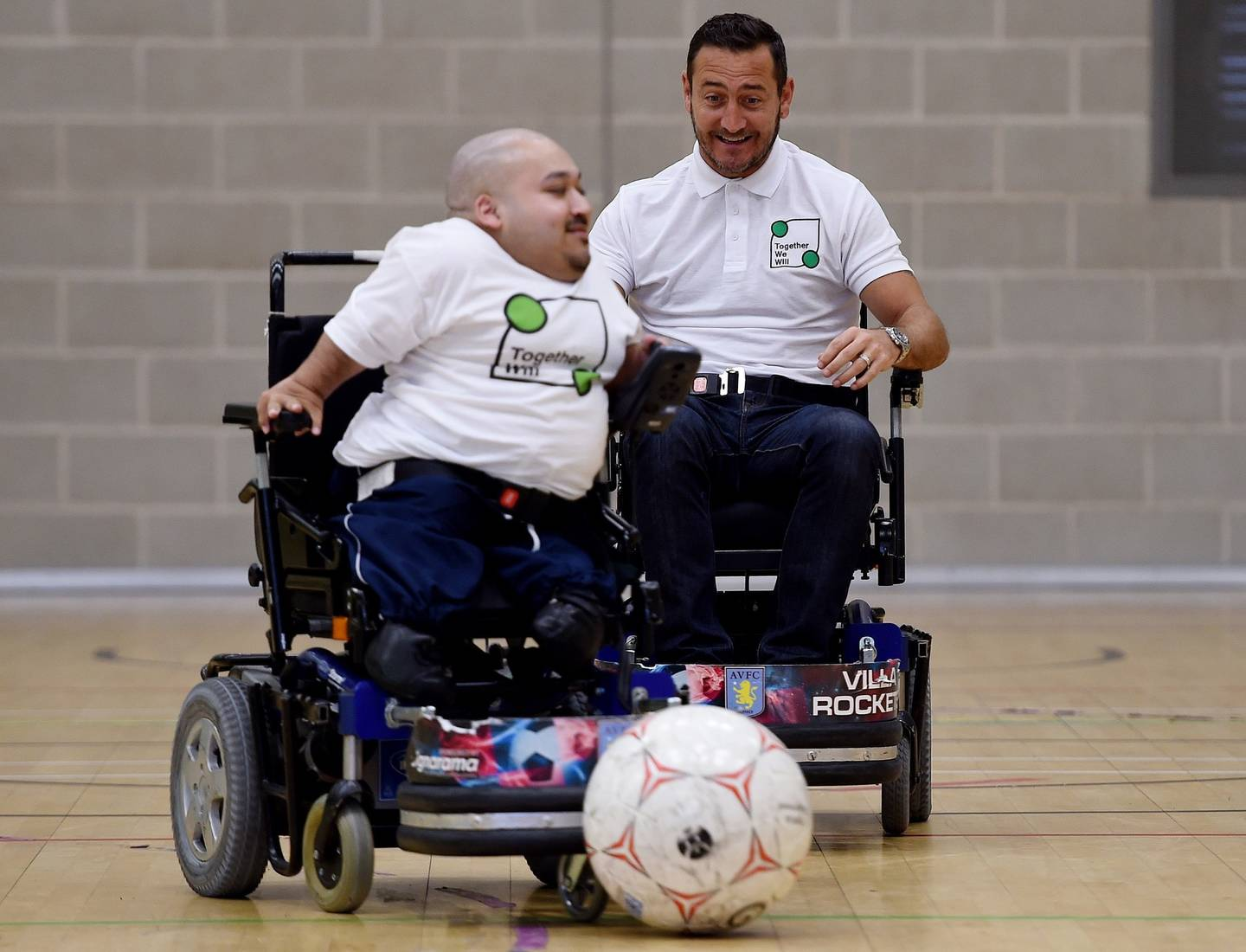Image shows Amir Ali and Will Mellor playing powerchair football.