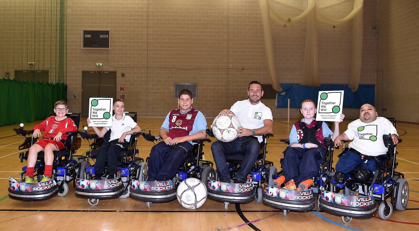 Image shows Will Mellor with Villa Rockets powerchair football players.