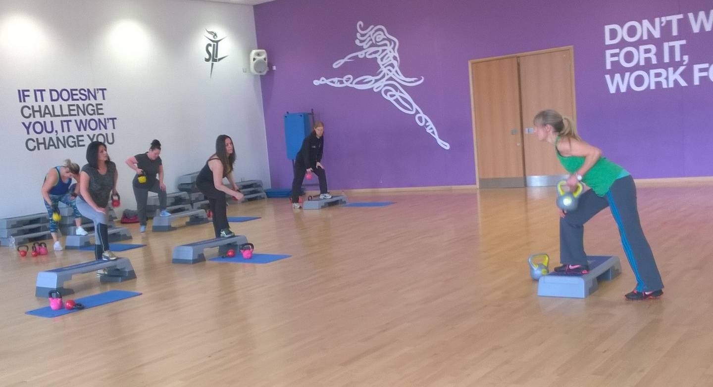 Image shows Wendy Hall leading an exercise class in dance studio.