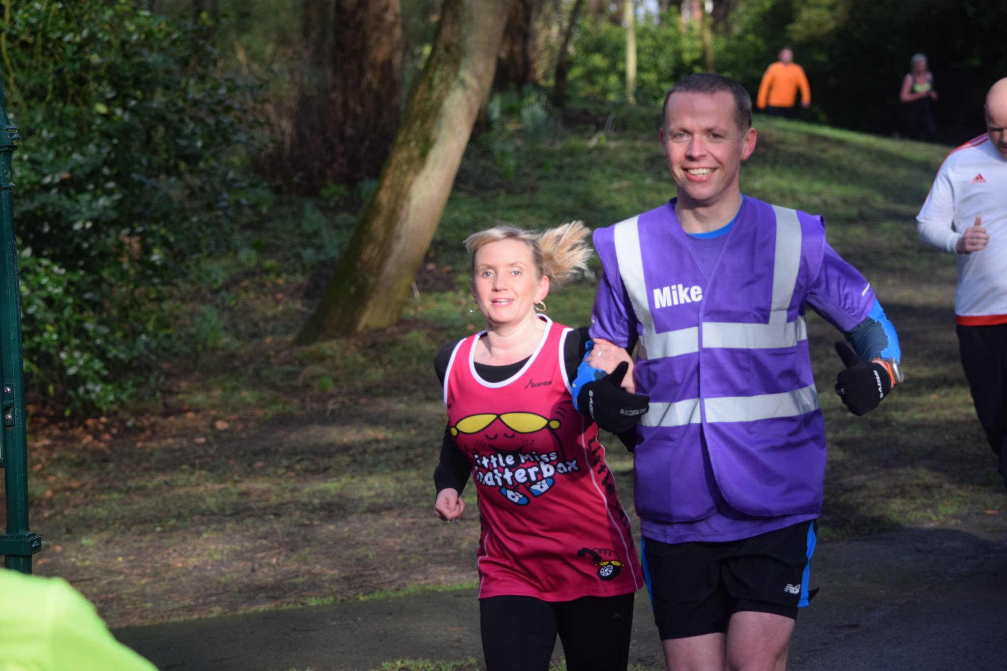 Kelly and Mike (guide) on a parkrun in Southport