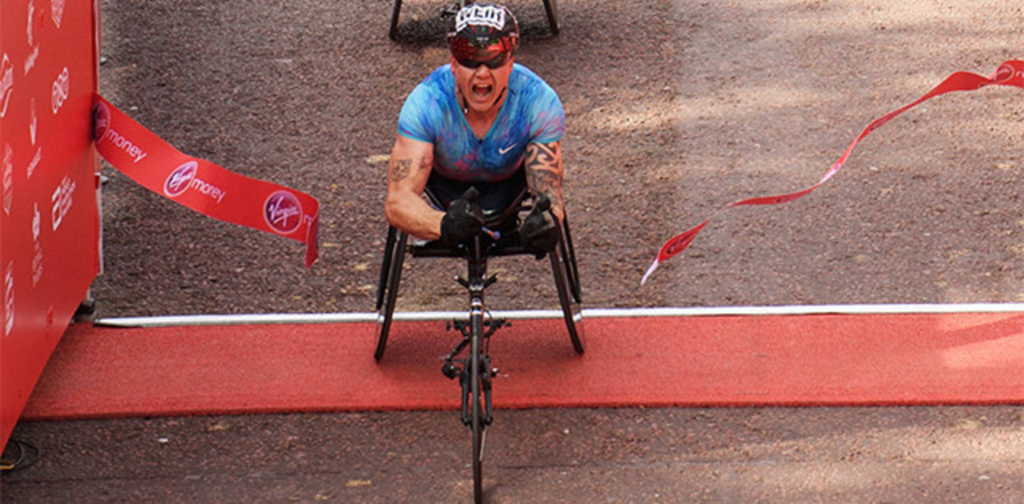 David Weir goes through the finishing tape
