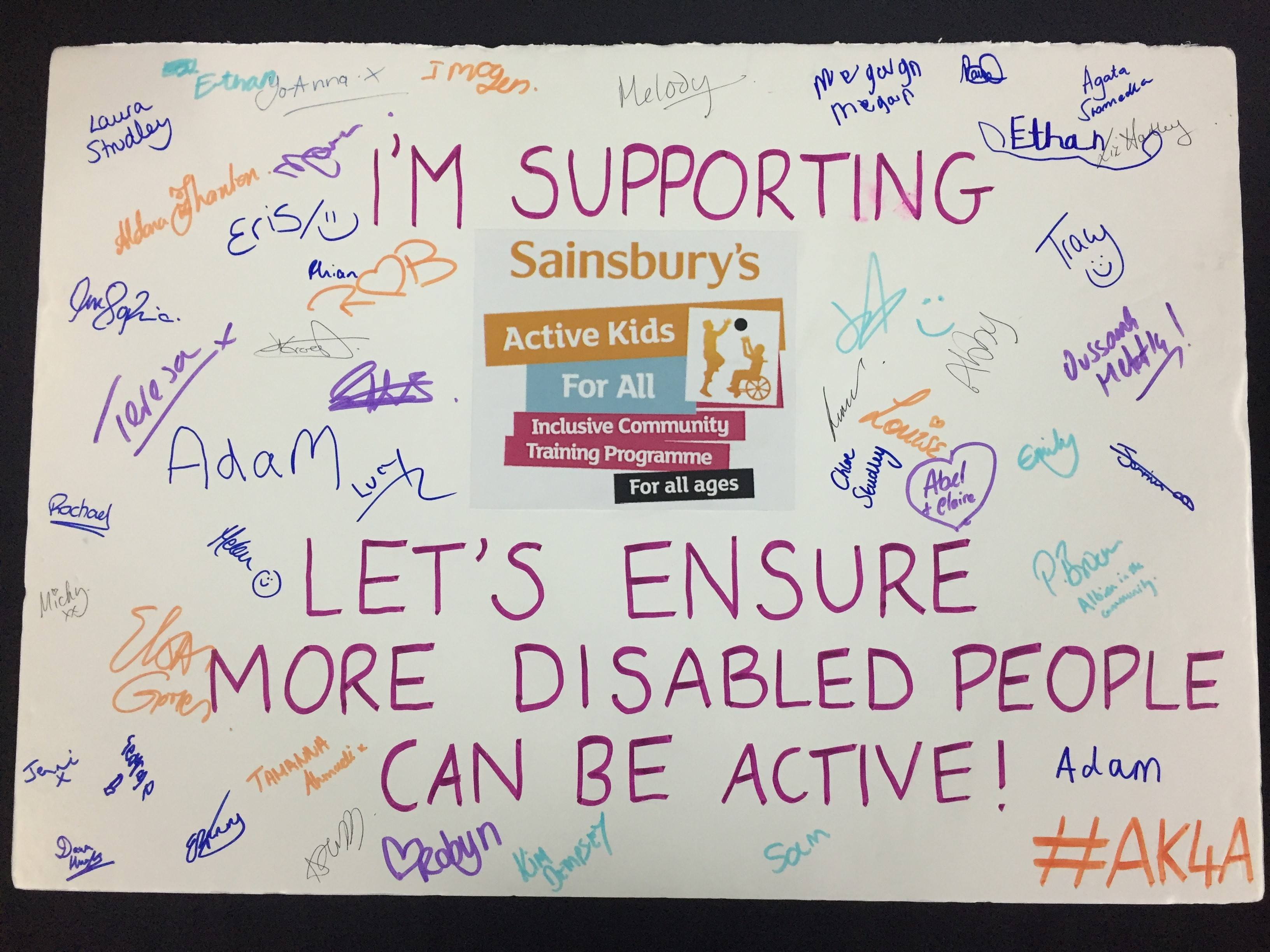 Signed pledge board reading 'Let's ensure more disabled people can be active!""