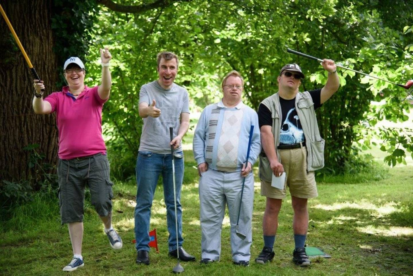 Disabled adults having fun playing golf