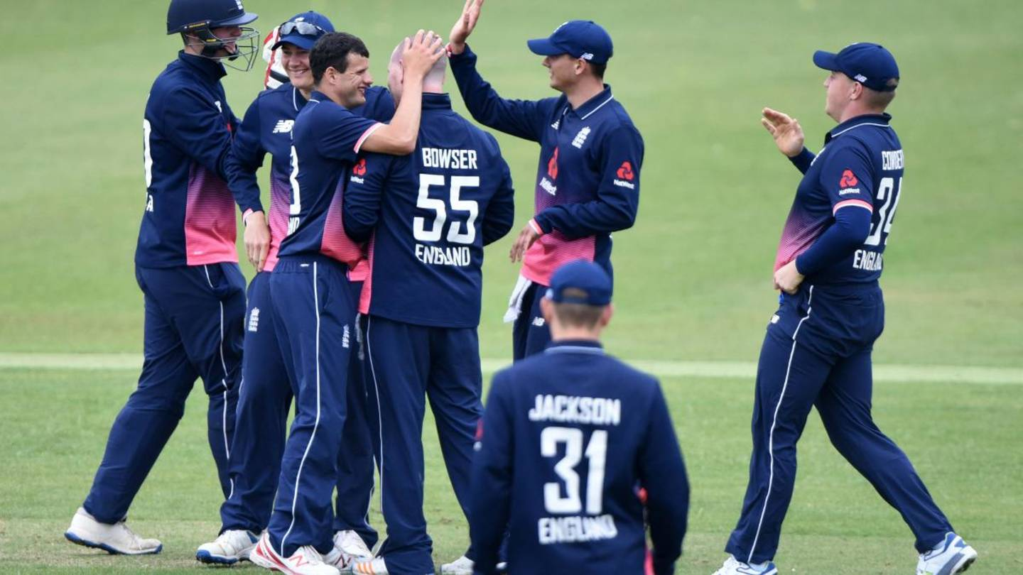 England learning disability cricket players celebrating on pitch.
