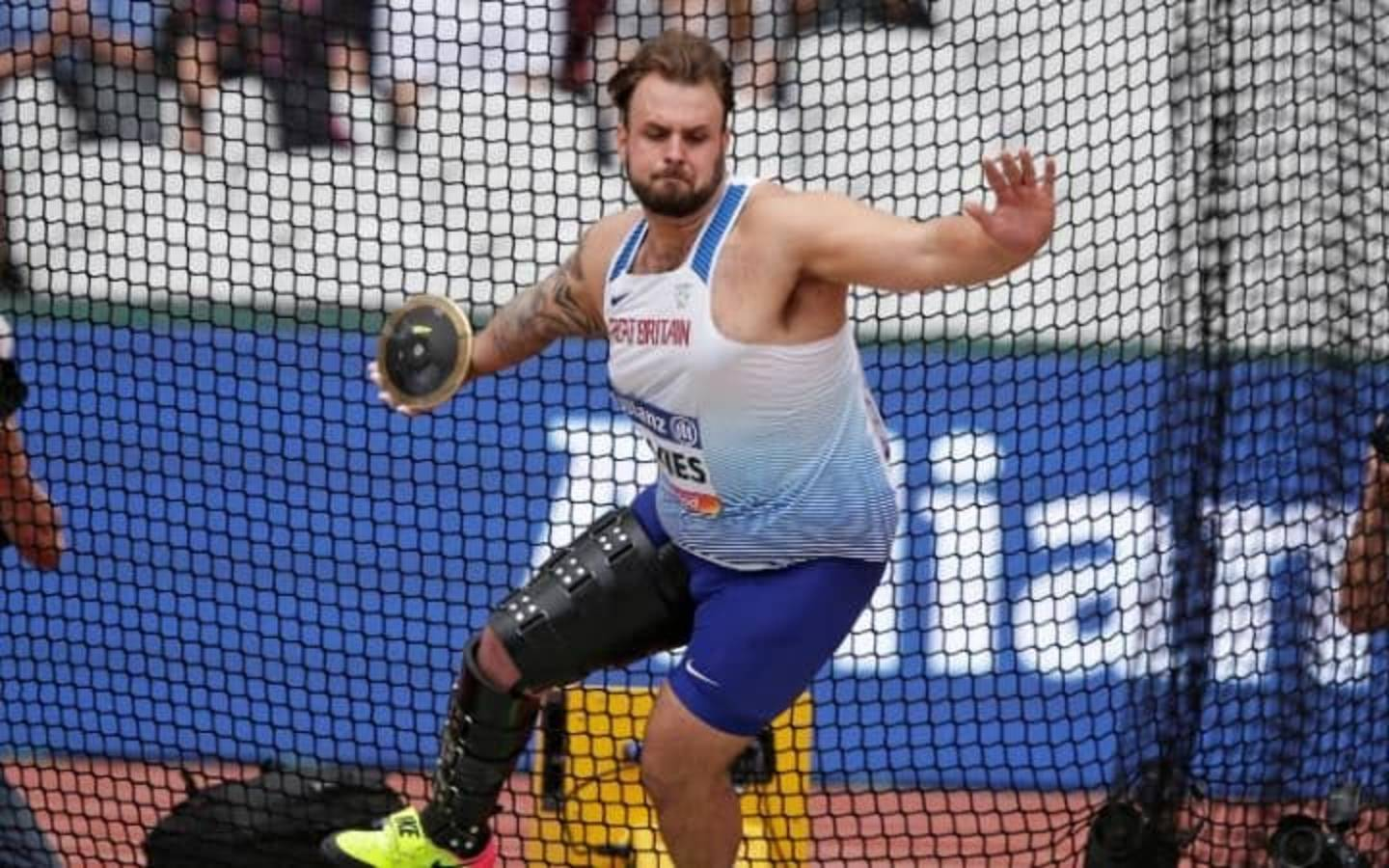 Athlete Aled Davies throwing discus at World Para Athletics Championships