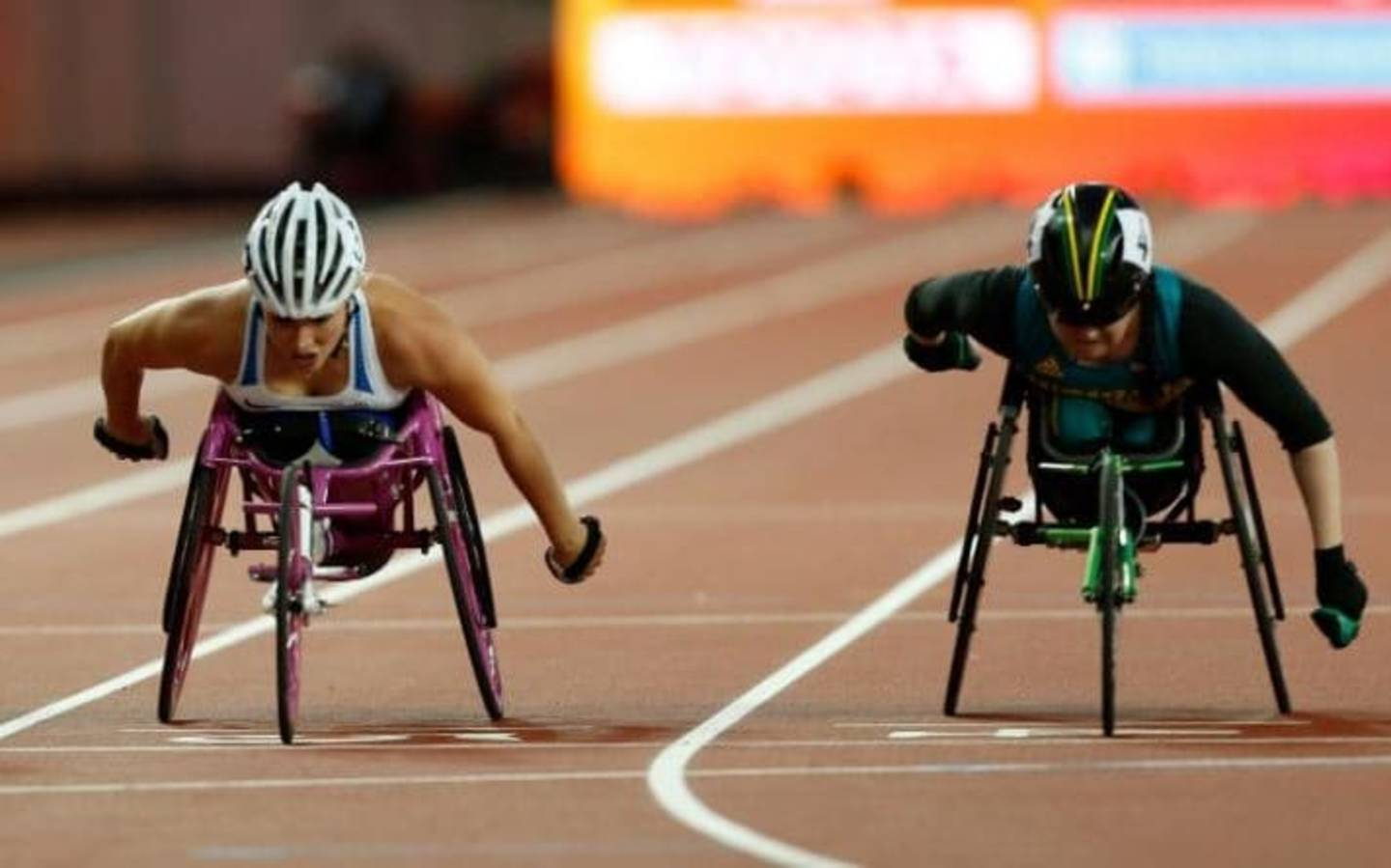 Wheelchair racer Sammi Kinghorn pushing in 400m final race on track