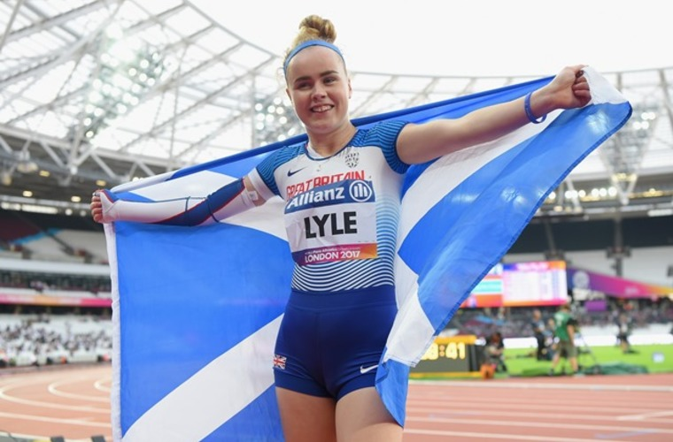 Sprinter Maria Lyle celebrating after winning bronze medal in sprint race