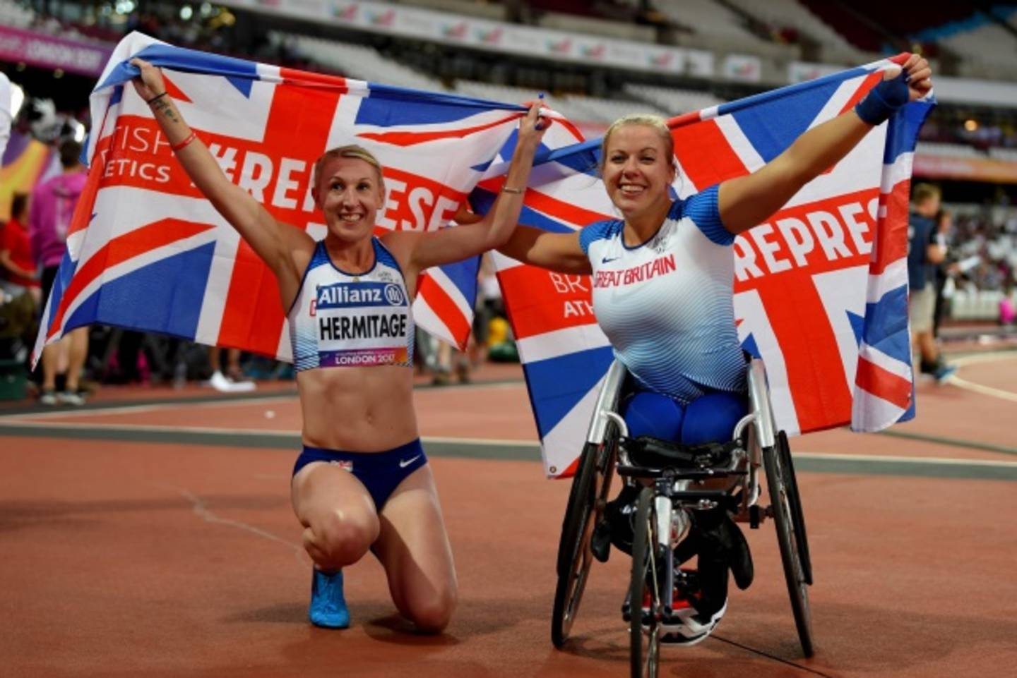 Georgina Hermitage and Hannah Cockroft holding GB flags to celebrate medal wins