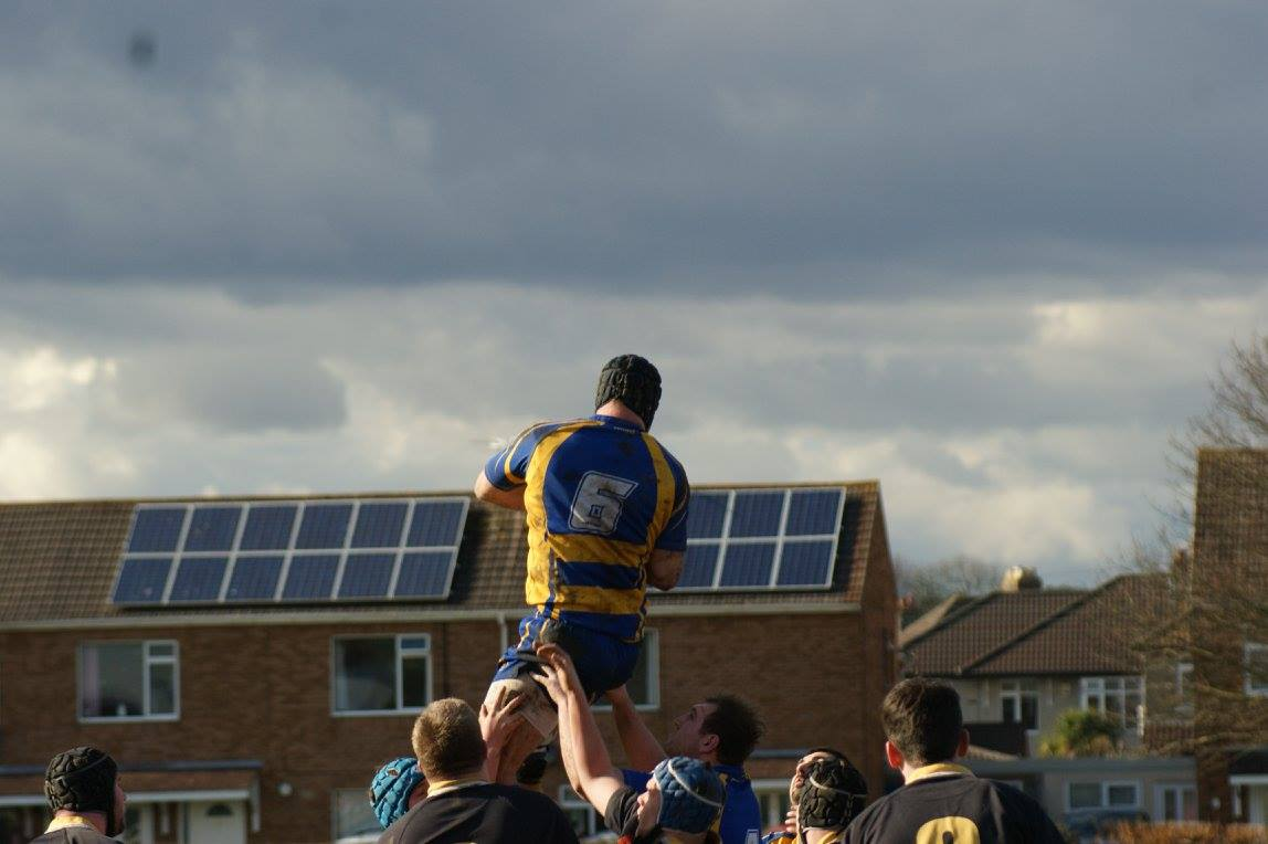 James Russell lifted by his team-mates to catch a rugby ball