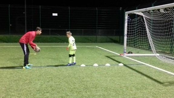 Ben Meadows teaching a young player to dribble through cones
