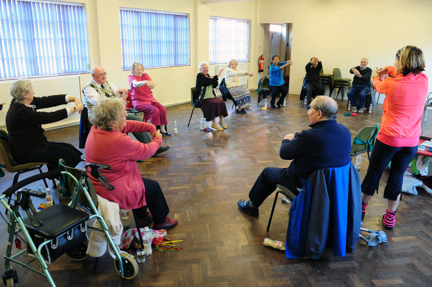 Older people taking part in an exercise class
