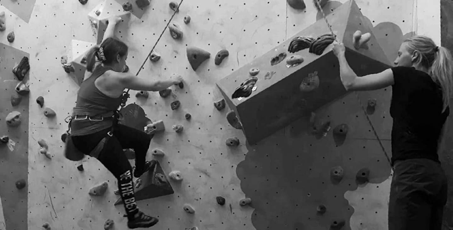 Lauren Sanders on the wall in an indoor climbing centre