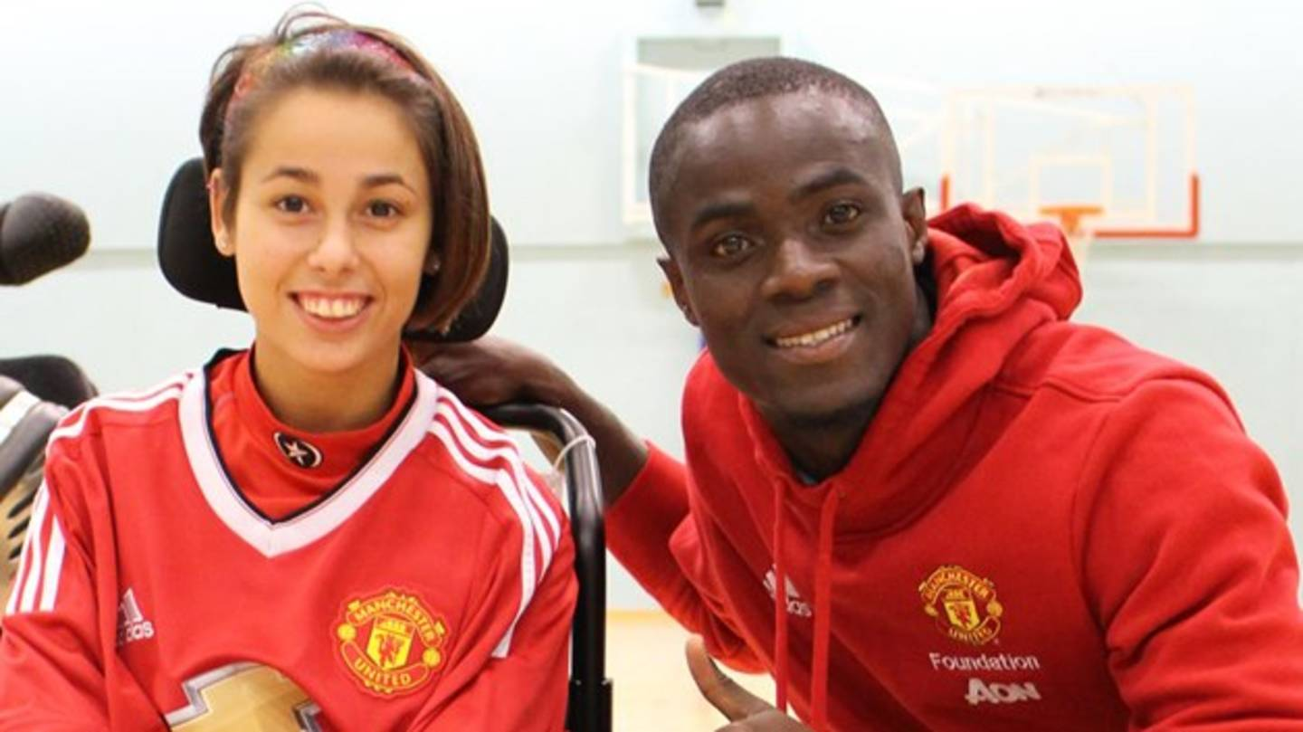 Eric Bailly with player Hannah at Manchester Utd powerchair launch