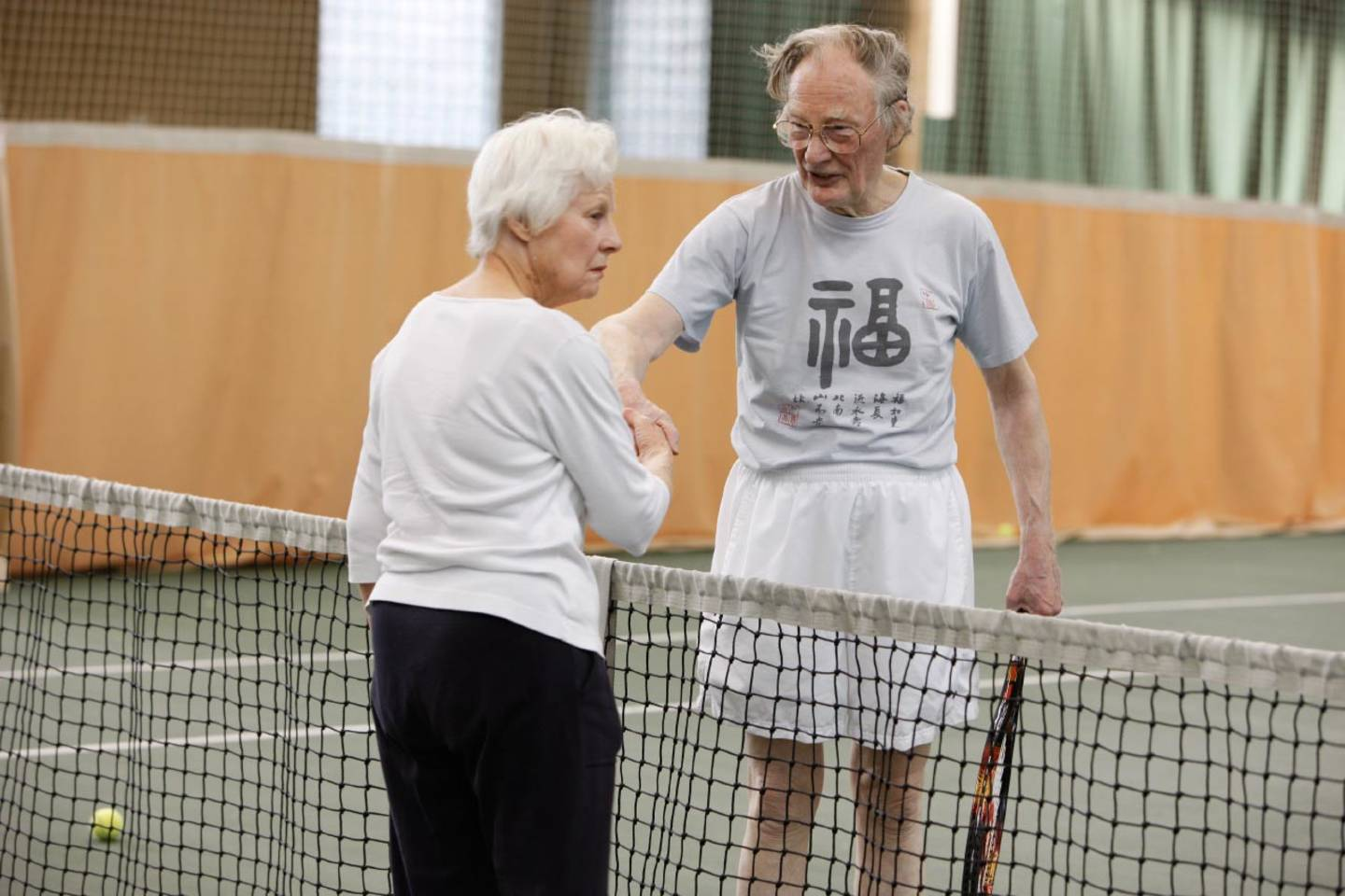 Older people playing tennis