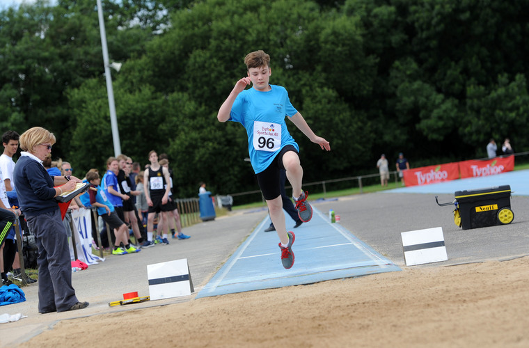 Athlete competing in the long jump at the Typhoo National Championships in 2017.