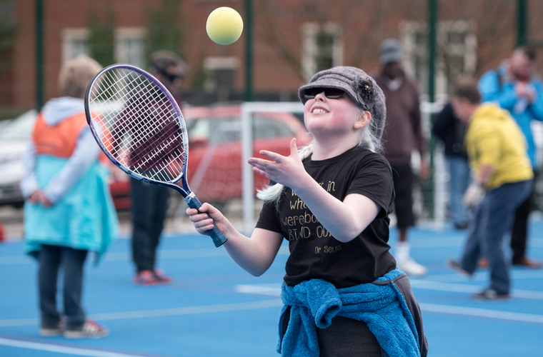 Girl with visual impairment playing tennis