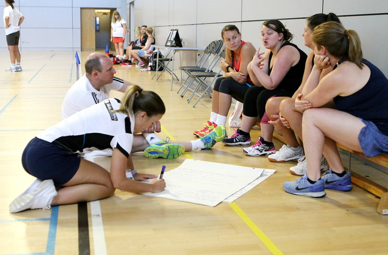 Photo of players discussing netball rules and adaptations for deaf players