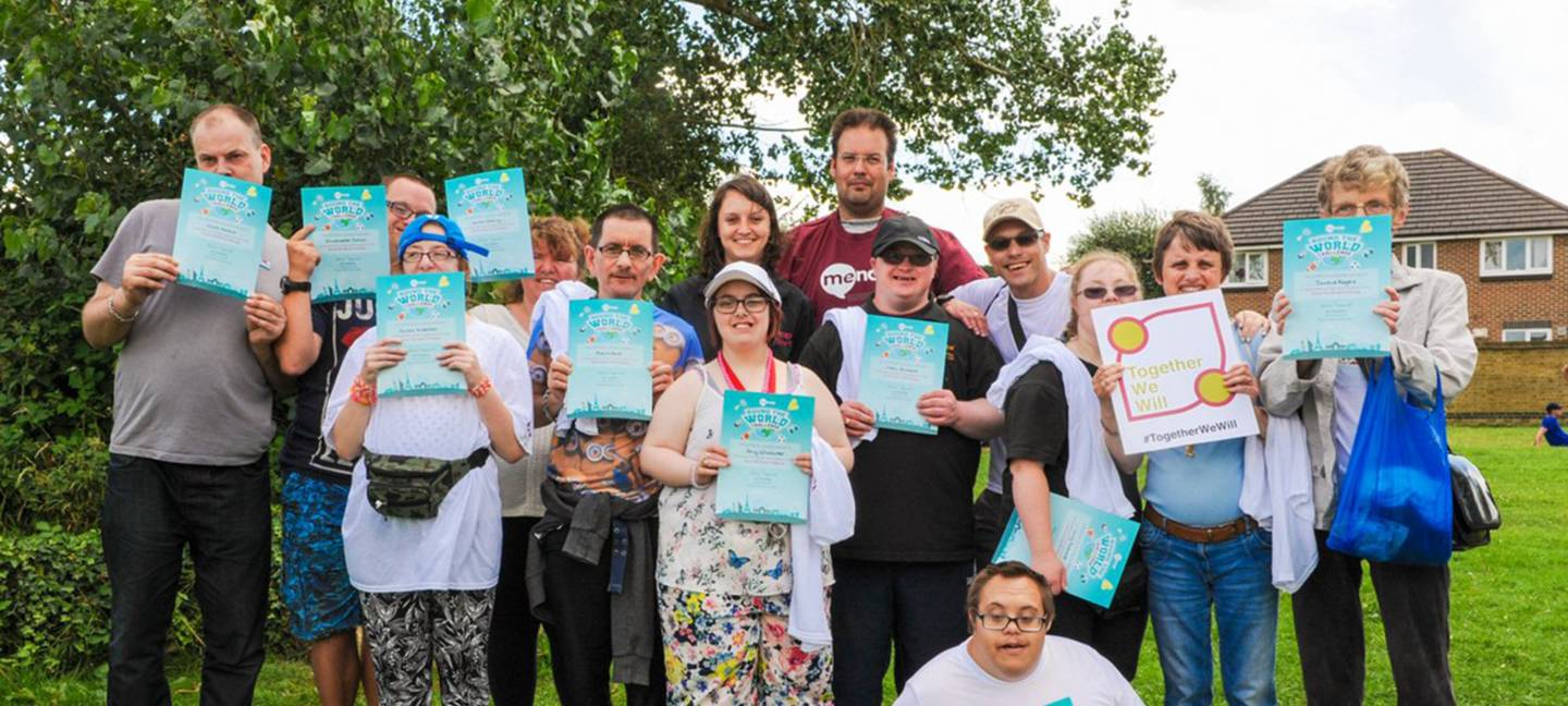People with learning disability holding their Round the world challenge certificates