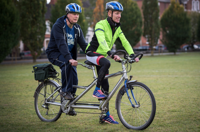 Visually impaired rider and sighted rider on tandem bike. Credit British Blind Sport