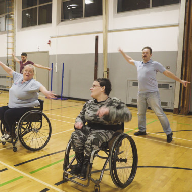 Wheelchair users and non-disabled people dancing