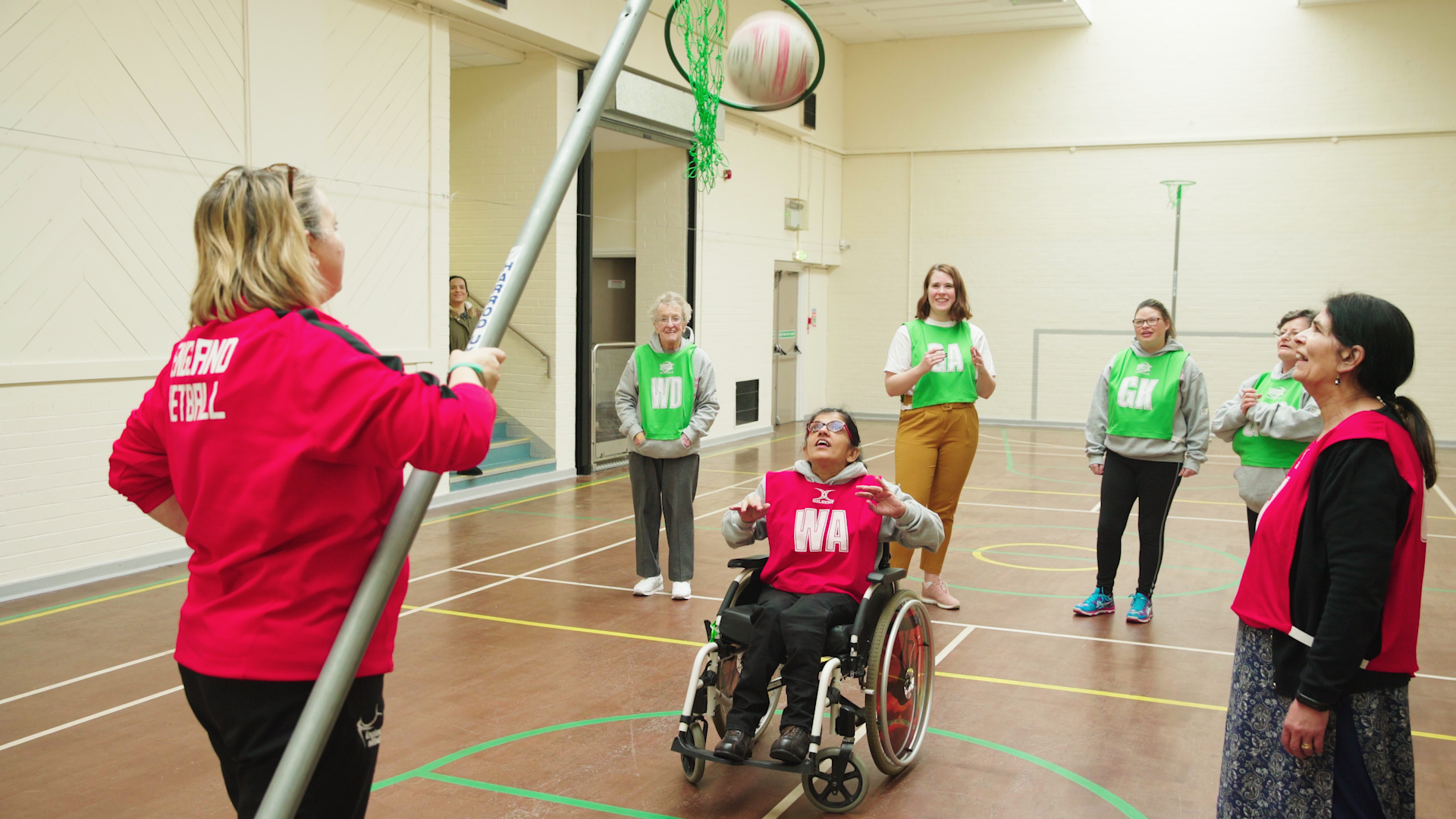 Wheelchair user shoots goal in inclusive netball session