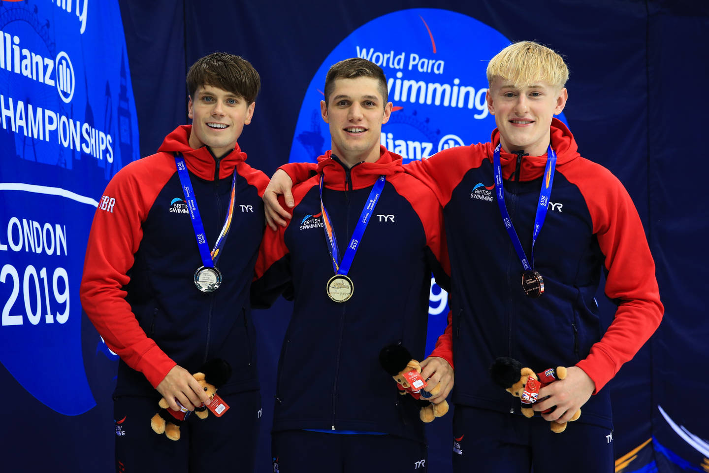 Reece Dunn, Tom Hamer and Jordan Catchpole wear medals on the podium