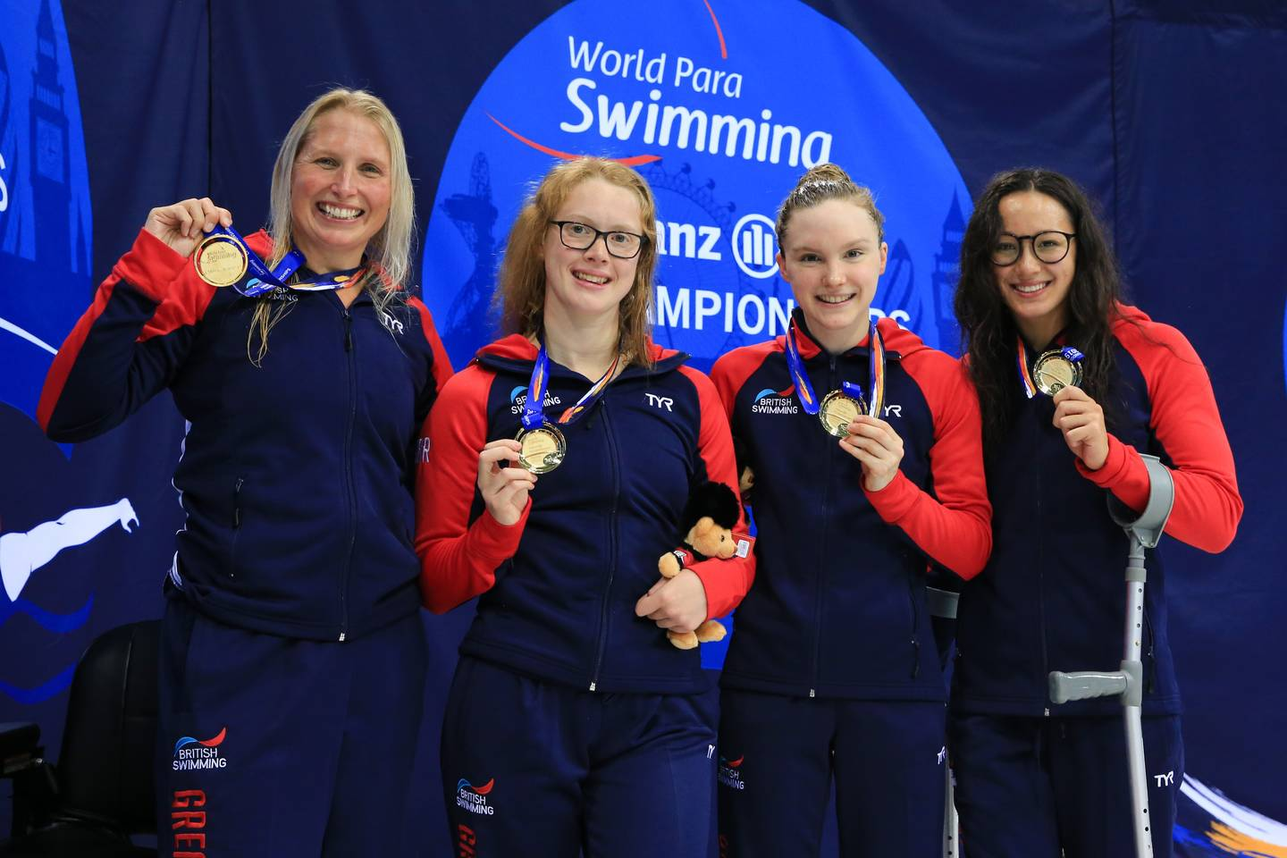 Women's 34pt 4x100m Freestyle Relay team with gold medals in hand.