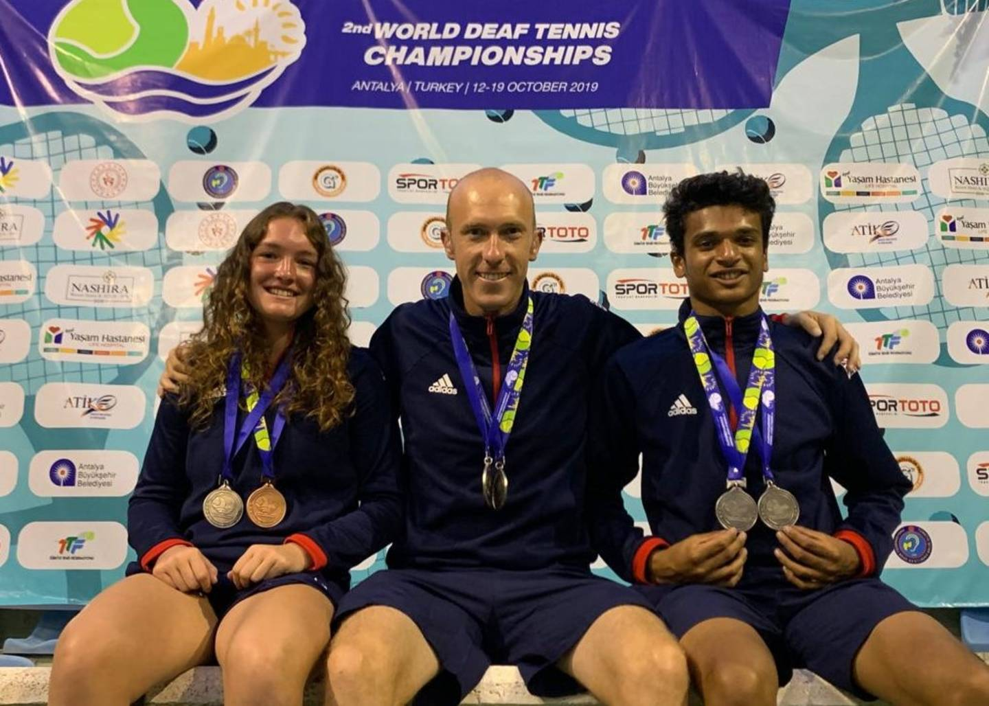 Lewis Fletcher, Phoebe Suthers and Esah Hayat wearing their World Deaf Tennis Championships medals