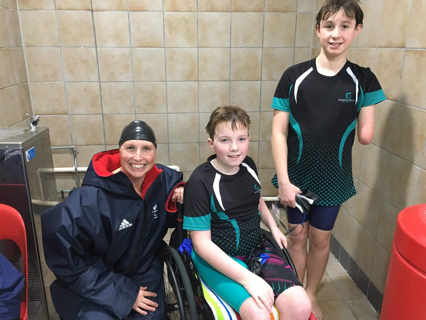 McKenzie with para-swimmer Steph Millward MBE on the left and his friend Jacob on the right.