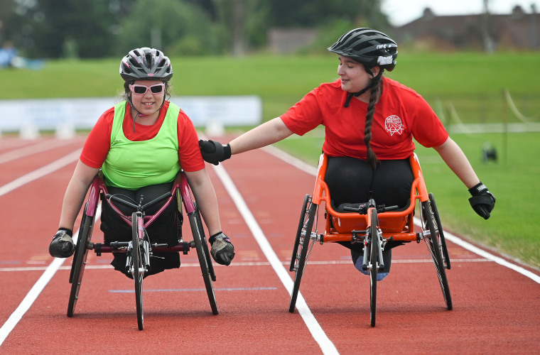 Two athletes at Activity Alliance National Junior Athletics Championships