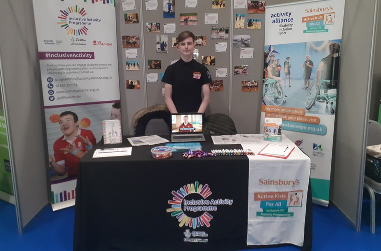 Josh working for Activity Alliance at Kidz in the Middle exhibition