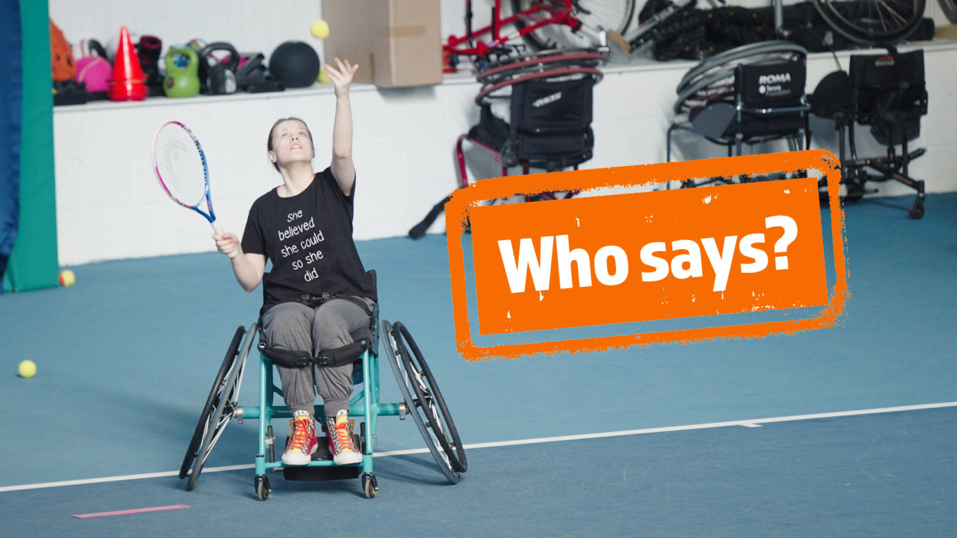 Young woman in wheelchair playing tennis