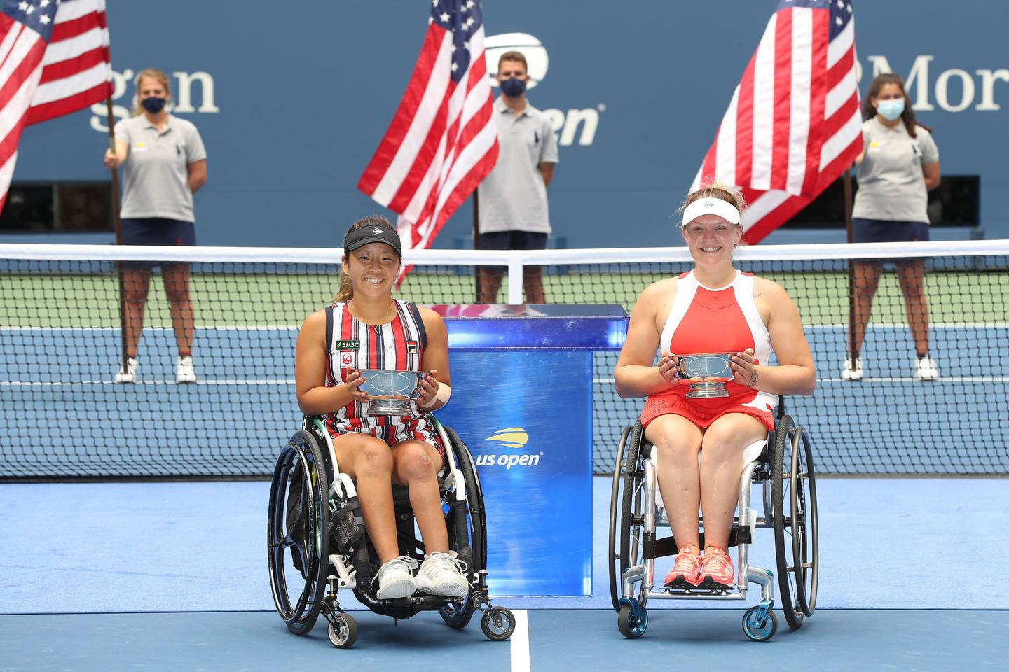 Jordanne Whiley and Yui Kamiji holding Women's Doubles Champions trophies.