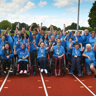 North West junior athletics team celebrating victory at National Championships 2019